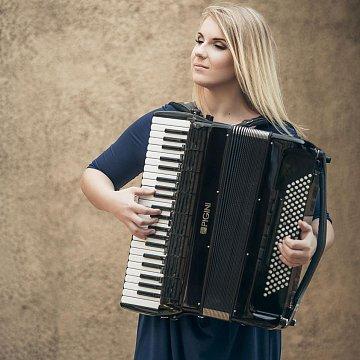 Private piano, accordion teacher in English language